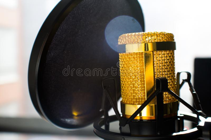 Close Up Photo of Gold-colored and Black Condenser Microphone stock image
