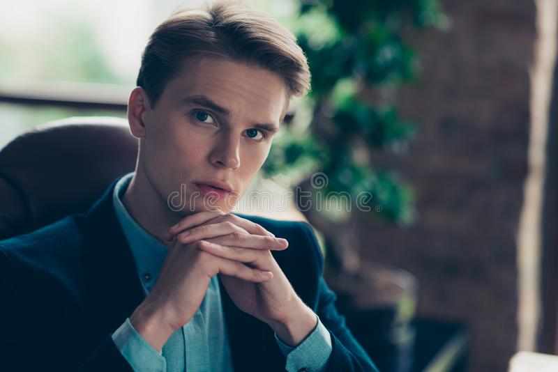 Close up photo of gorgeous handsome brutal guy touch chin hands focused concentrated think thoughtful company wear tux. Tuxedo suit jacket interior industrial royalty free stock photo