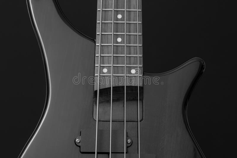 Close Up Photo of Gray Electric Bass Guitar royalty free stock photo