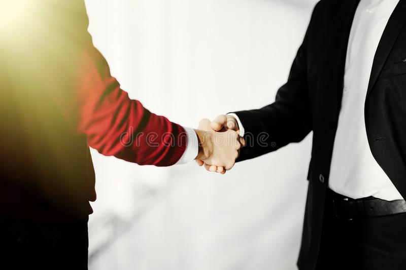Close-up photo of handshake of two successful businessmen in office royalty free stock photos
