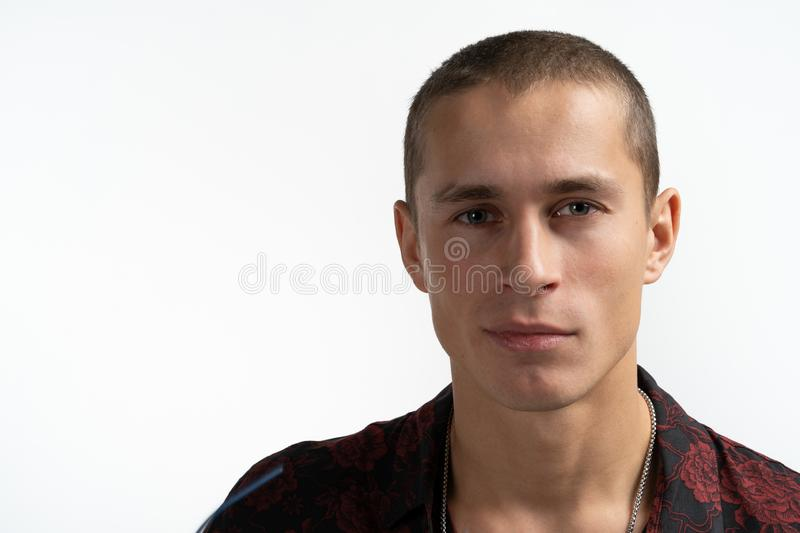 Close up photo of handsome attractive serious man that loooking at the camera isolated over white background stock images