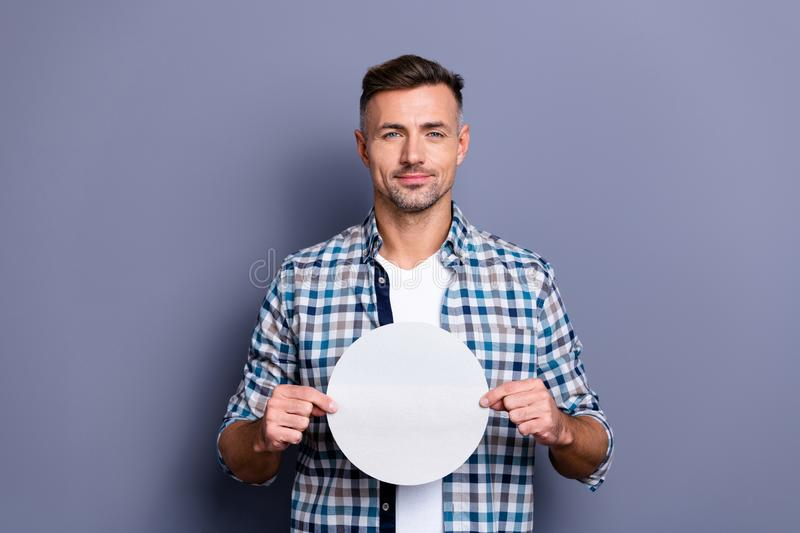 Close up photo handsome he him his guy arms hands holding round circle shape figure form paper list creative designer royalty free stock images