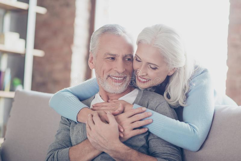 Close up photo of happy joyful beautiful couple of old people who give to each other so warm hugs stock image
