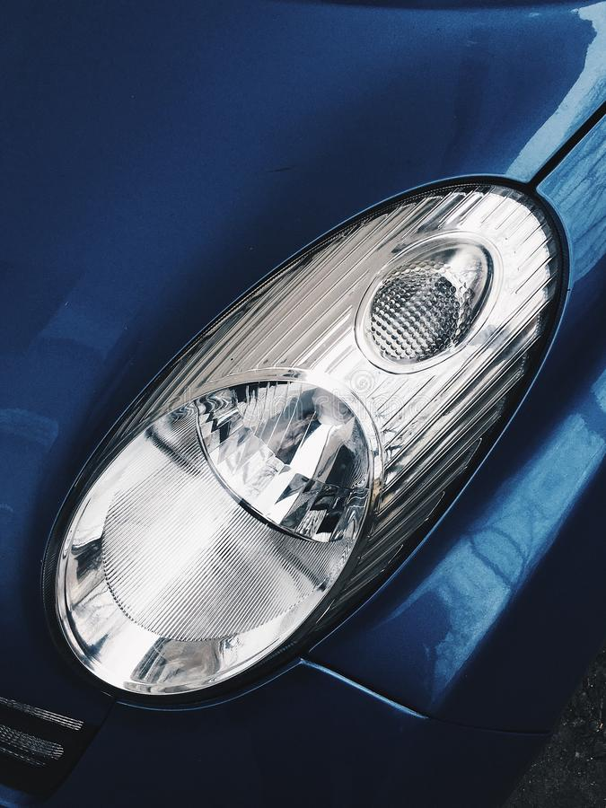 A close-up photo of a headlight in a car royalty free stock photo