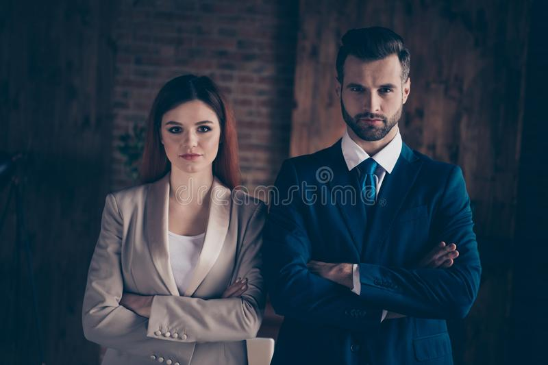 Close up photo she her business lady he him his guy achievement serious people folded arms union unity unite self. Confident couple pair we are champions best royalty free stock photo