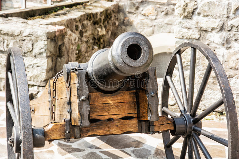 Close up photo of historic cannon. Retro object. Military theme stock photo
