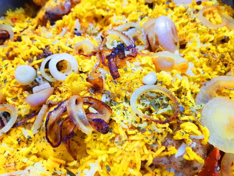 Close up photo of hyderabadi dum handi biryani garnished with onions stock images