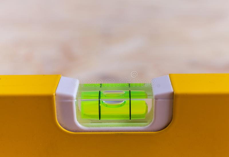 Close up photo of a leveling tool bubble level being used royalty free stock images