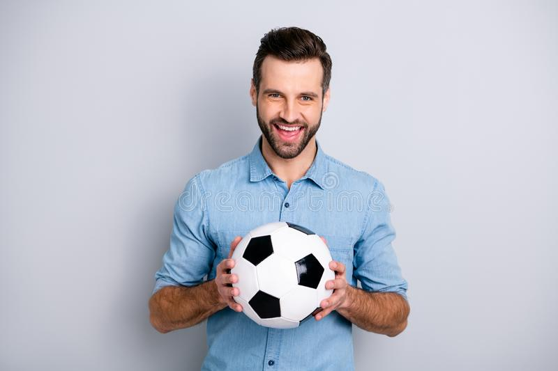 Close up photo macho he him his guy hold football white black leather ball watch match game true fan laugh laughter royalty free stock photos