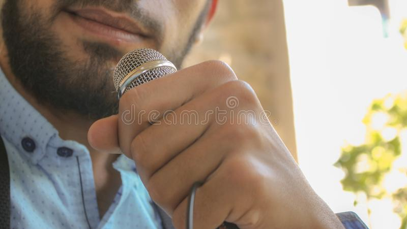 Close-up Photo of Man Holding Microphone stock photo