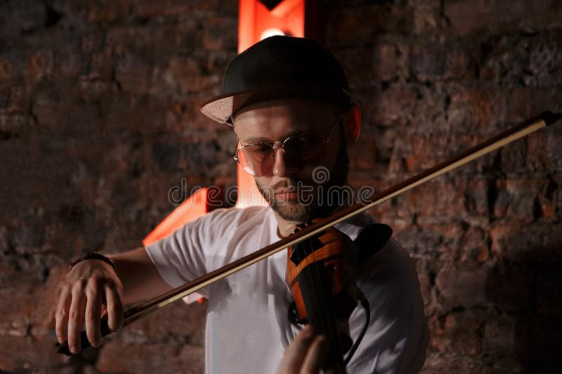 Close-up photo of man playing electric violin stock photography