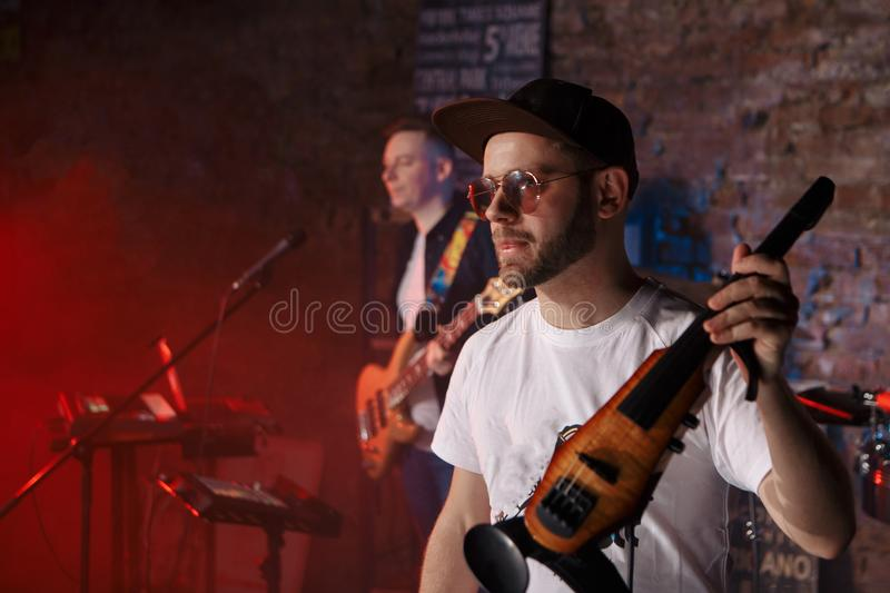 Close-up photo of man playing electric violin stock images
