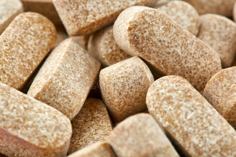 Close-up photo of many brown pills. Medicine.  royalty free stock image