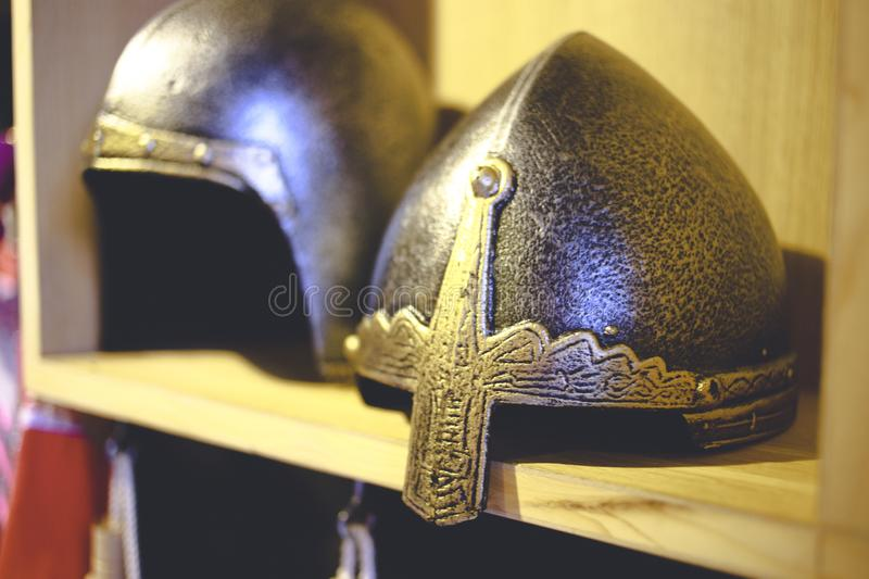 Close-up photo of medieval helmet , ancient warrior iron knight shining style . Concept of old vintage traditions , extreme fight stock image