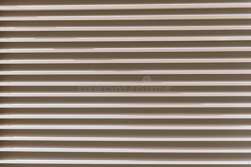 Close-up photo of metal surfaces. Abstract interior background. Modern architecture detail. Close-up photo of metal surfaces. Abstract interior background stock photos