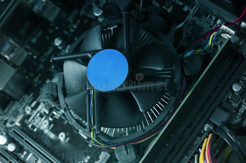 Close up photo with motherboard of computer and its fan. Hi tech background royalty free stock photos