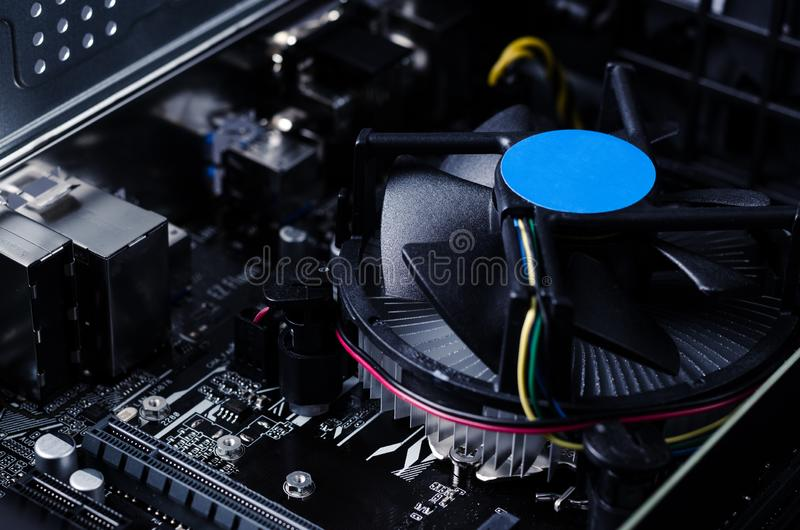 Close up photo with motherboard of computer and its fan. Hi tech background royalty free stock photography
