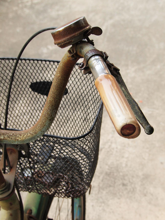Close up photo of old, dirty and rusty bicycle handlebar. stock image