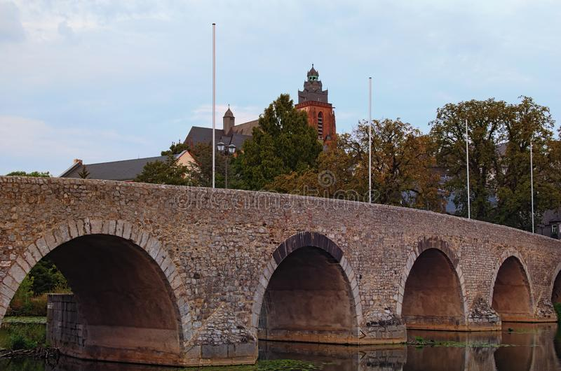 Close-up photo of Old Lanh Bridge in Wetzlar. City park and The Wetzlar Cathedral at the background. Autumn landscape photo. stock photography