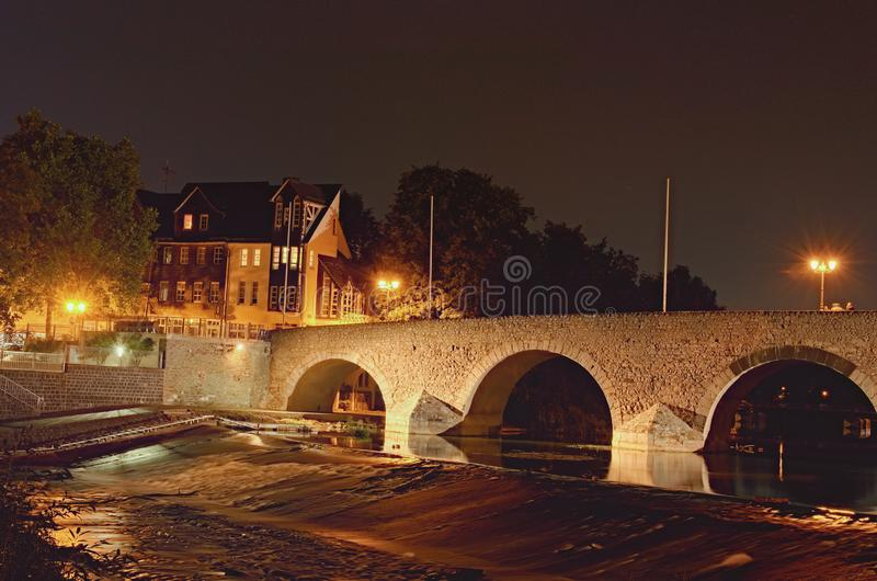 Close-up photo of Old Lanh Bridge in Wetzlar, State of Hesse, Germany. Scenic autumn night landscape photo royalty free stock images