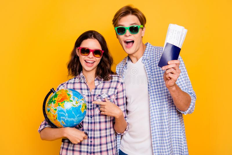 Close up photo of pair love in summer specs he him his she her lady boy with globe and tickets in hands glad to pick stock photography