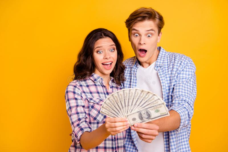 Close up photo of pair with pack of bucks in hands he him his she her lady boy eyes mouth wide opened lucky luck rich royalty free stock photos