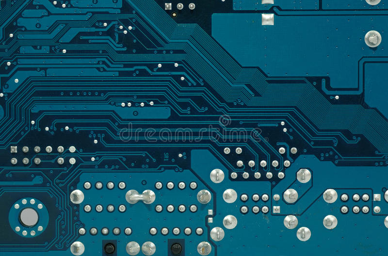 Close up photo of part of a motherboard. Circuit board close up , digital highway concept royalty free stock image