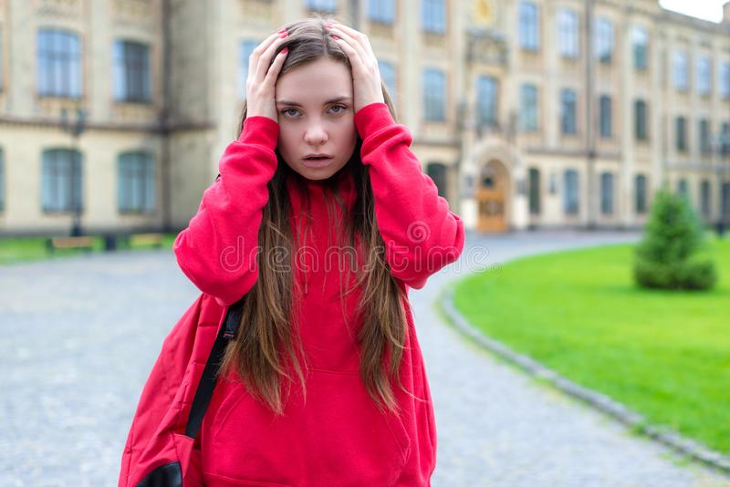 Close up photo of pessimistic anxious having trouble problem with lessons do not understand overslept important exam. After party stock photography