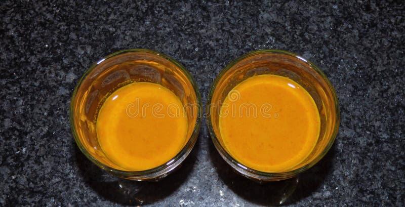 Raw Turmeric shot - Plant Based Food stock photo