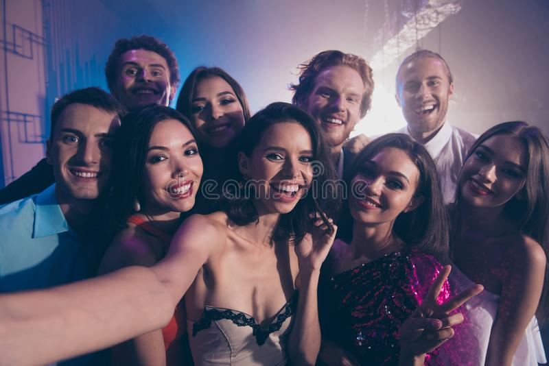 Close up photo portrait of friends cuddle to each other and take royalty free stock image