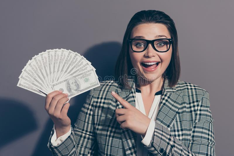 Close up photo portrait of laughing cheerful she her lady demonstrating many lot much money in hand looking at camera stock image