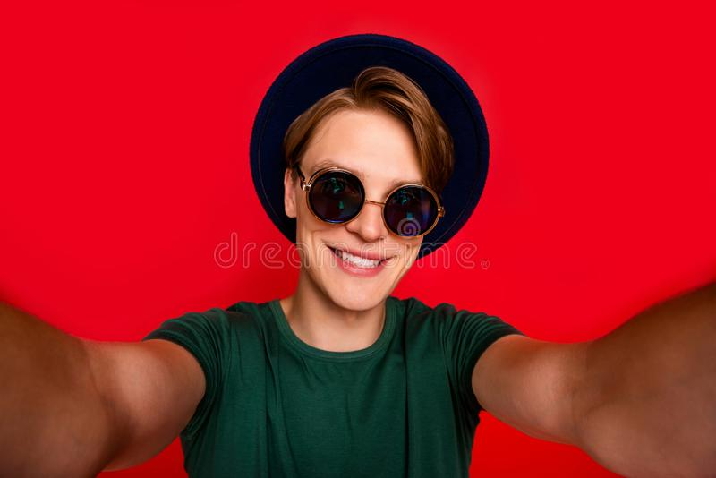 Close up photo of positive cheerful guy on summer holidays take selfie for his blog wear casual style clothing isolated royalty free stock images