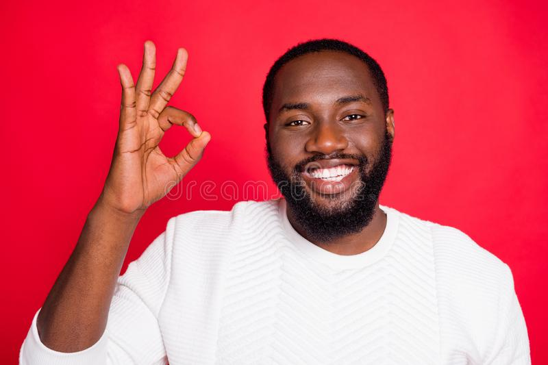 Close up photo of positive emotion cool dark skin man show ok sign recommend promo ads choose decide promotion wear. Close up photo of positive emotion cool dark royalty free stock photos