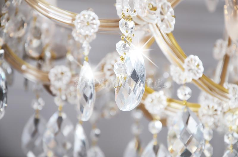 Close-up photo of the scenery on the old chandelier. Glass figures shine and reflect light with their faces royalty free stock photos