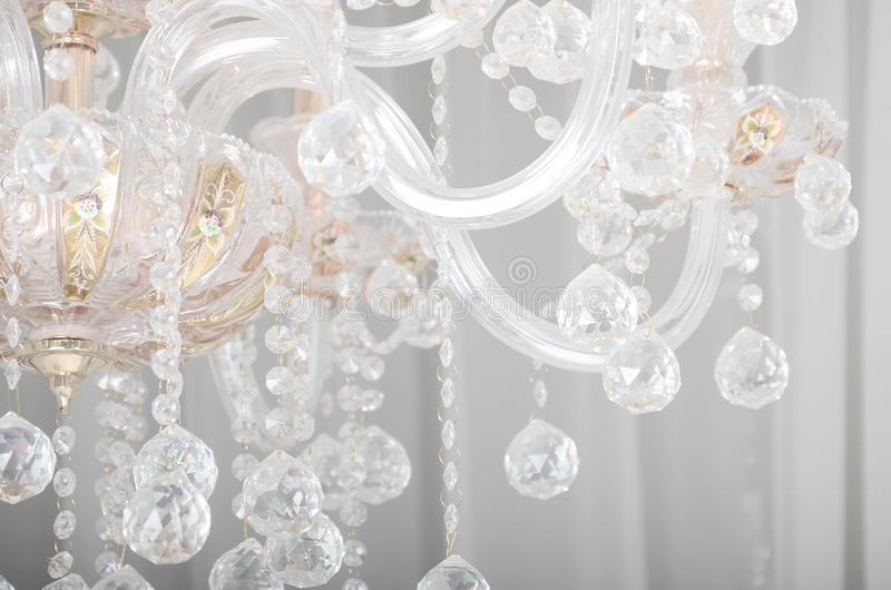 Close-up photo of the scenery on the old chandelier. Glass figures shine and reflect light with their faces stock photos