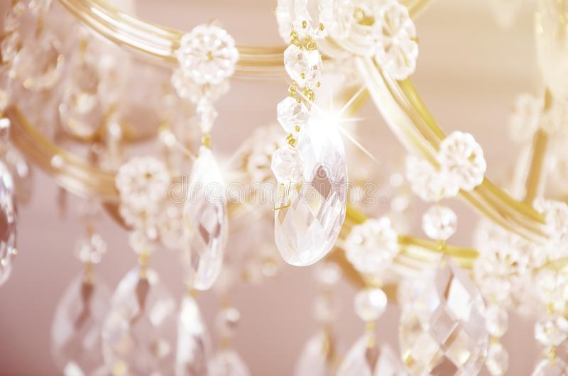Close-up photo of the scenery on the old chandelier. Glass figures shine and reflect light with their faces stock photography