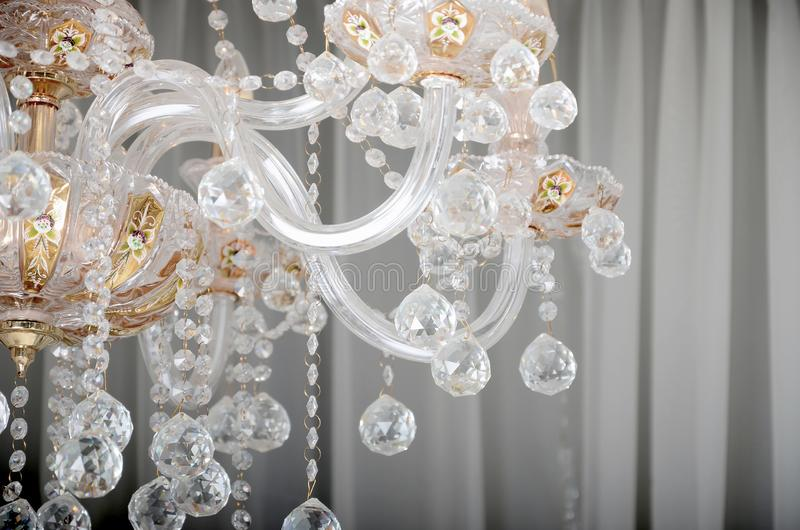 Close-up photo of the scenery on the old chandelier. Glass figures shine and reflect light with their faces royalty free stock photography