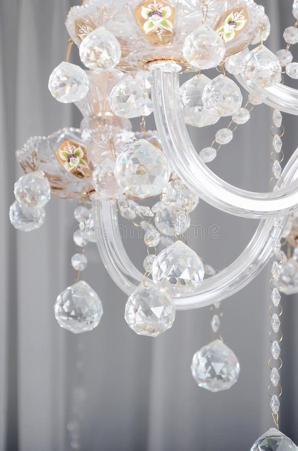 Close-up photo of the scenery on the old chandelier. Glass figures shine and reflect light with their faces royalty free stock photo