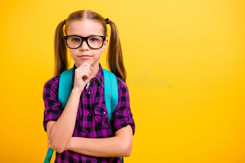 Close up photo of small lady pupil hold hand chin pretty ponytails lesson wear specs checkered shirt isolated yellow stock images