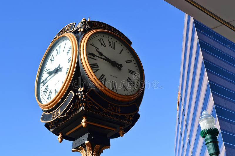 Close-up Photo of Street Clock Near Tall Building stock image