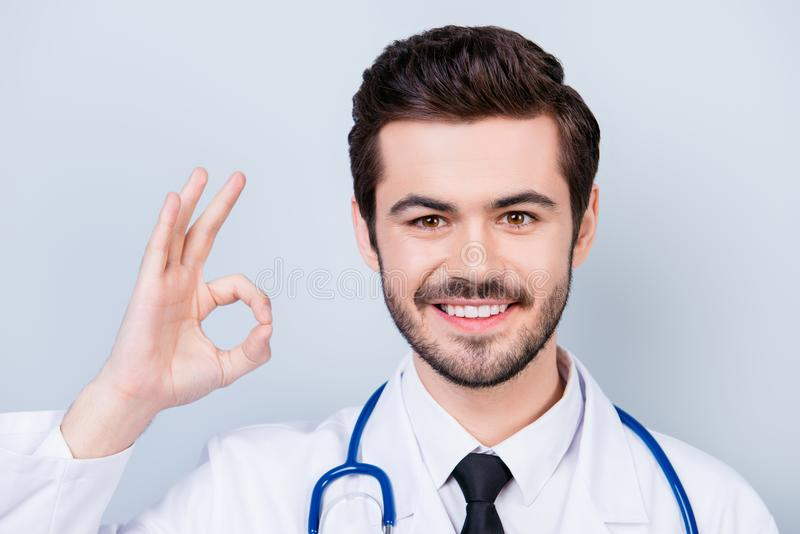 Close up photo of successful experienced smiling doctor showing royalty free stock images