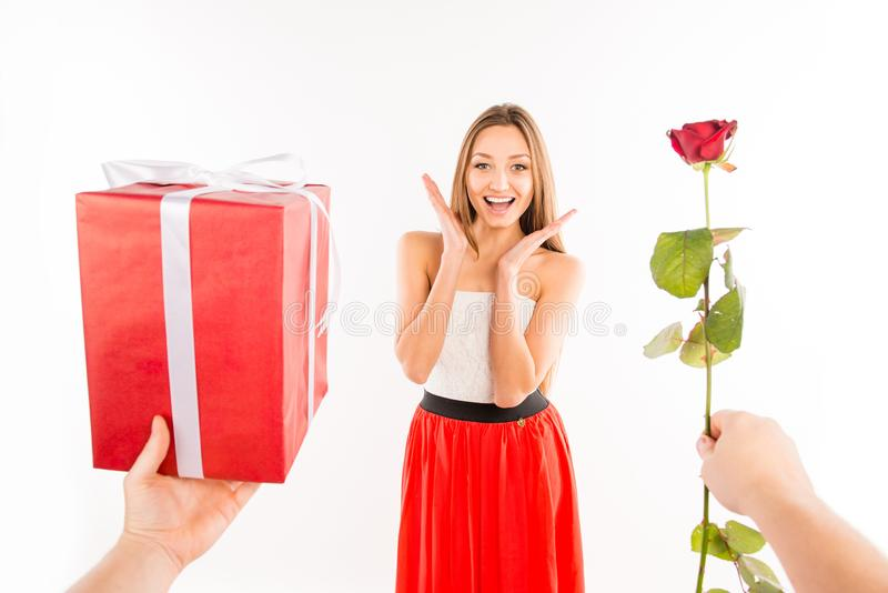 Close up photo of surprised girl presented by rose and gift stock photos