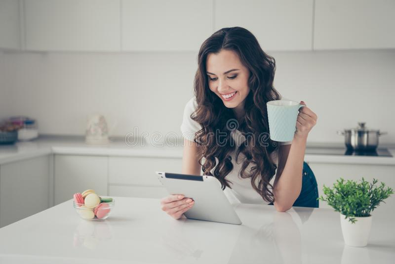 Close up photo sweet beautiful brunette she her lady homey indoors housewife watch e-reader hold beverage read reader stock photos
