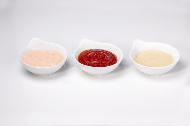 Close up photo of three different dipping dressing sauces royalty free stock images