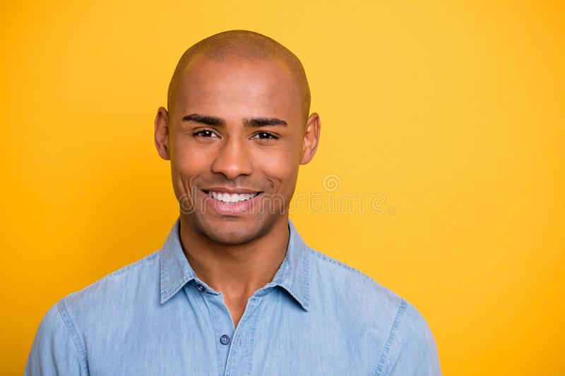 Close up photo of toothy dark skin macho positive mood wear jeans denim shirt isolated bright yellow background. Close up photo of toothy dark skin, macho stock image