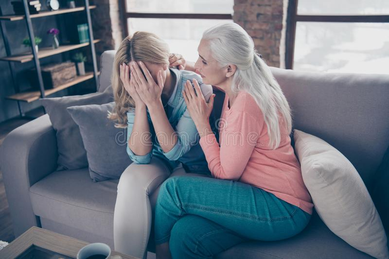 Close up photo two beautiful she her ladies granddaughter tell speak say share difficulties divorce husband cheating. Hide tears face arms granny calm down sit stock photos