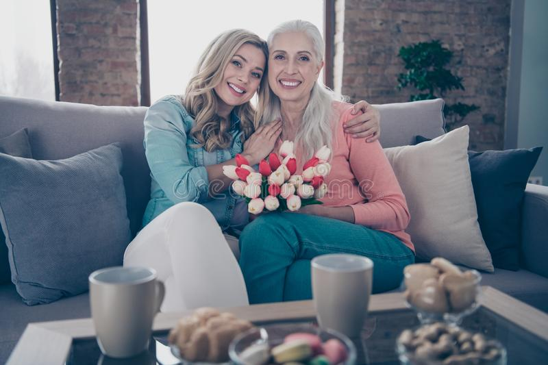 Close up photo two people she her ladies grandmother grandchildren visit birthday party fresh flowers overjoyed enjoy royalty free stock photo