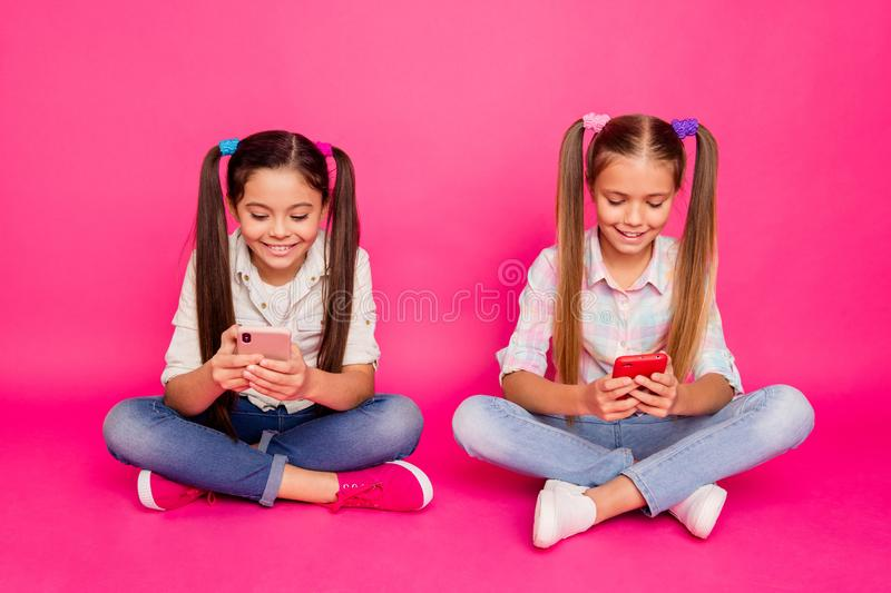 Close up photo two people little age she her girls hold hands arms telephones chatting parents sit floor wear casual stock images