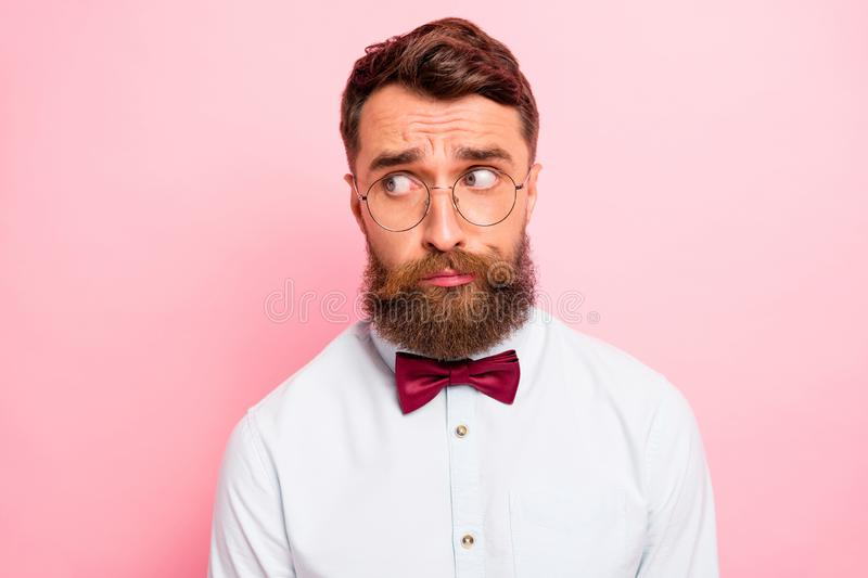 Close-up photo of uncertain unsure modest geek person wearing formal clothing does not know what to do looking aside royalty free stock photo