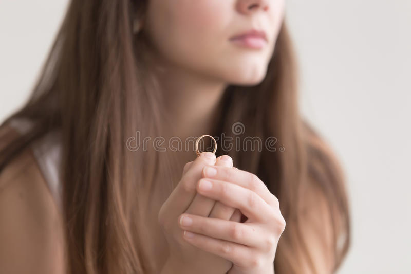 Close up photo of wedding ring in womans hands royalty free stock image